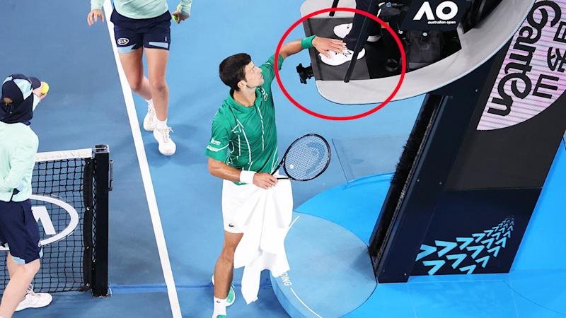 Novak Djokovic, pictured here patting the umpire's foot during the Australian Open final.