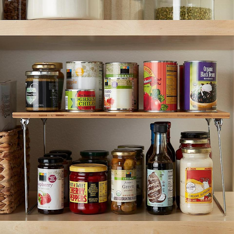 """<p>You'll create so much extra space with this <a href=""""https://www.popsugar.com/buy/Medium-Bamboo-Stackable-Shelf-542385?p_name=%20Medium%20Bamboo%20Stackable%20Shelf&retailer=containerstore.com&pid=542385&price=18&evar1=casa%3Auk&evar9=47184923&evar98=https%3A%2F%2Fwww.popsugar.com%2Fhome%2Fphoto-gallery%2F47184923%2Fimage%2F47184996%2FMedium-Bamboo-Stackable-Shelf&list1=shopping%2Ccleaning%2Corganization%2Cspring%20cleaning%2Chome%20organization%2Chome%20shopping&prop13=api&pdata=1"""" rel=""""nofollow"""" data-shoppable-link=""""1"""" target=""""_blank"""" class=""""ga-track"""" data-ga-category=""""Related"""" data-ga-label=""""https://www.containerstore.com/s/medium-bamboo-stackable-shelf/d?productId=11002183&amp;q=kitchen%20cabinet%20organizert"""" data-ga-action=""""In-Line Links""""> Medium Bamboo Stackable Shelf </a> ($18).</p>"""
