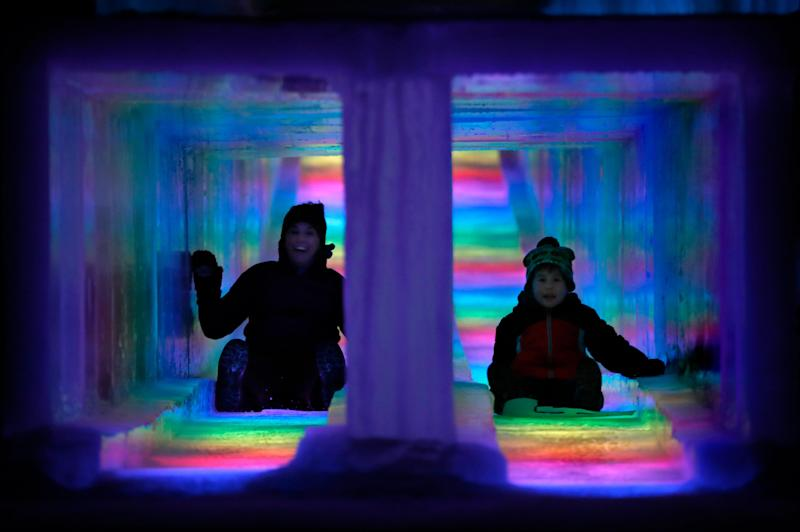 Visitors race down the side-by-side tunnels of a 97-foot ice slide at Ice Castles in North Woodstock, N.H. The winter wonderland is one of six in North America. (Photo: Robert F. Bukaty/AP)