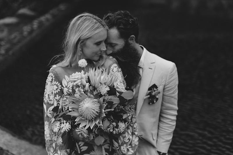 The NSW South Coast couple are pictured here on their wedding day. They said they were 'completely gutted' when they heard some of their guests had tested positive to coronavirus.