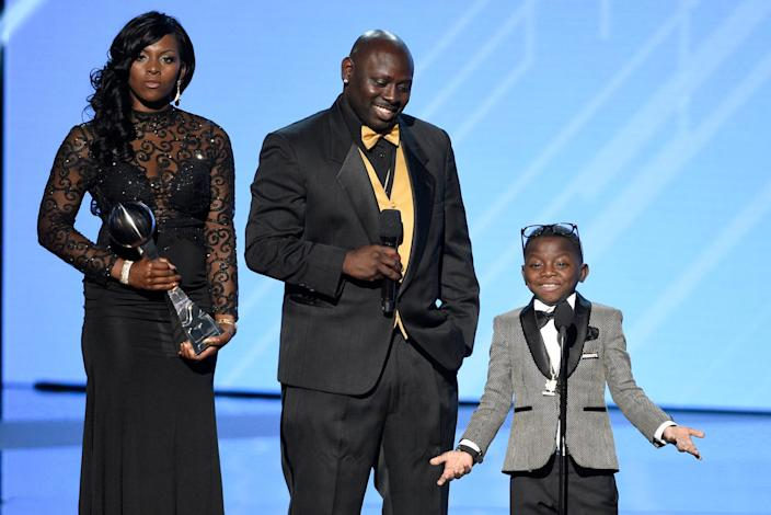 """Saints super fan Jarrius """"J.J."""" Robertson, right, accepts the Jimmy V perseverance award with his parents, from left, Patricia Hoyal and Jordy Robertson at the 2017 ESPYS."""