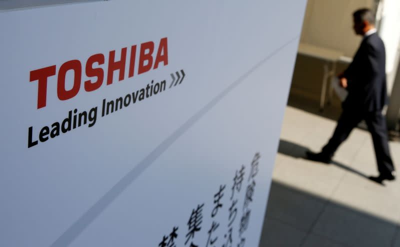 FILE PHOTO: The logo of Toshiba is seen as a shareholder arrives at an extraordinary shareholders meeting in Chiba, Japan