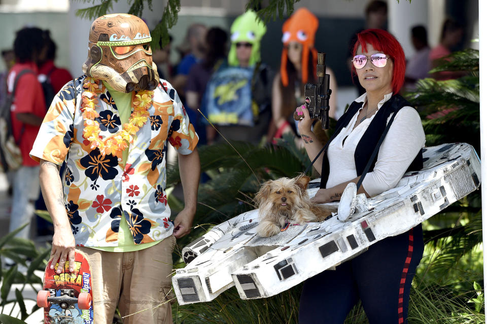 <p>Jamie Solano dressed as a Stormtrooper and Nicki Solano dressed as Han Solo with her dog Penny Lane sitting in a Millennium Falcon carrier at Comic-Con International on July 20 in San Diego. (Photo: Chris Pizzello/Invision/AP) </p>