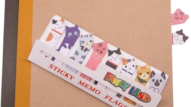 These sticky notes feature little kitty heads that pop out between pages.