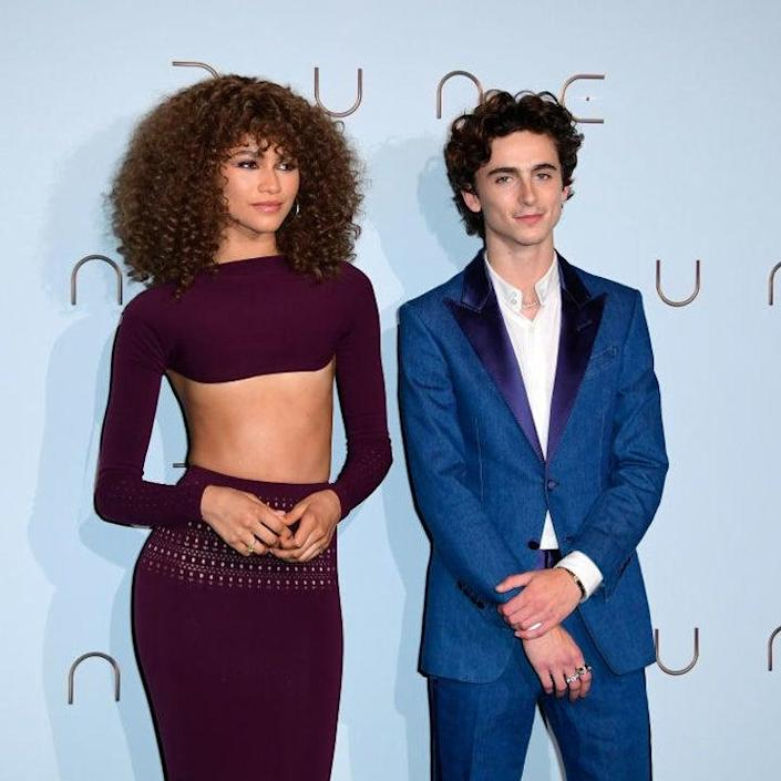 Zendaya wore a knit long-sleeved crop top and a matching long skirt andTimothée wore a casual suit Le Grand Rex