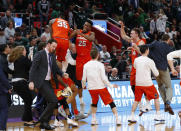 Syracuse players celebrate after defeating Michigan State in an NCAA men's college basketball tournament second-round game in Detroit, Sunday, March 18, 2018. (AP Photo/Paul Sancya)