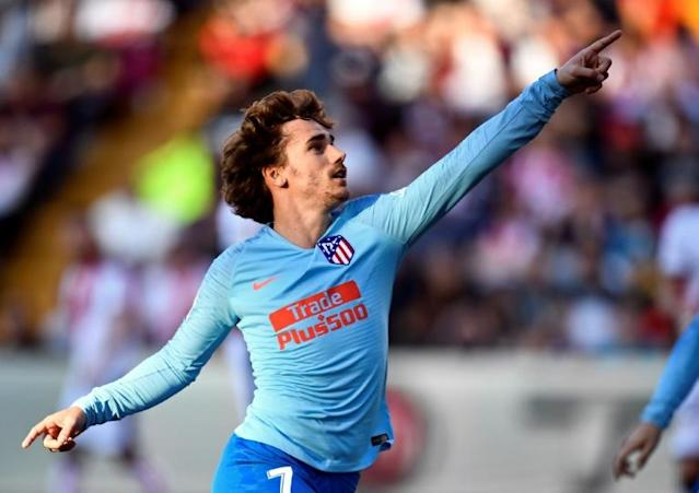 Press reports in Spain say Antoine Griezmann's transfer from Atletico to Barcelona will go in front of FIFA (AFP Photo/OSCAR DEL POZO)