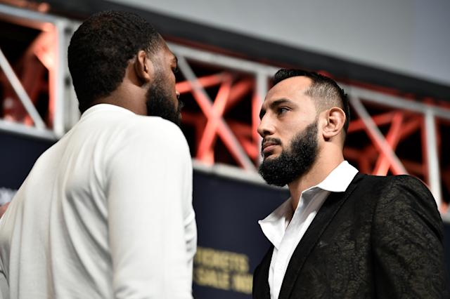 (R-L) Dominick Reyes and Jon Jones face off during the UFC 247 press conference at T-Mobile Arena on Dec. 13, 2019 in Las Vegas. (Chris Unger/Zuffa LLC via Getty Images)