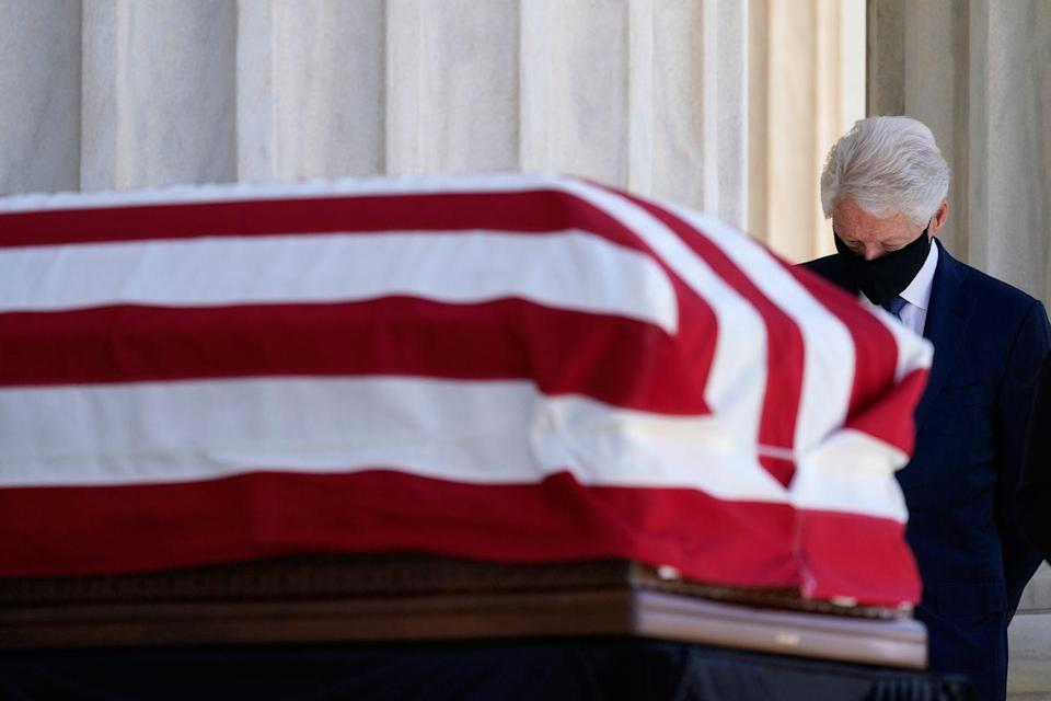 <p>Former President Bill Clinton pays his respects at the casket bearing the remains of Justice Ruth Bader Ginsburg at the U.S. Supreme Court where she will lie in repose, on September 23, 2020 in Washington, DC. Ginsburg, appointed to the high court by Clinton in 1993, died September 18 of complications due to pancreatic cancer.</p>