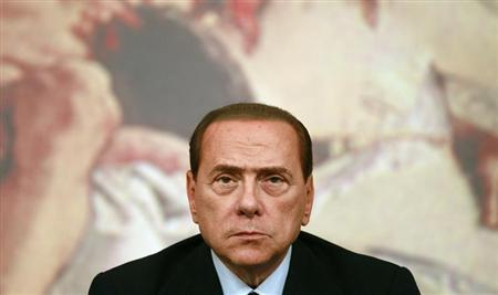 Italy's Prime Minister Berlusconi looks on during a news conference at Chigi Palace in Rome