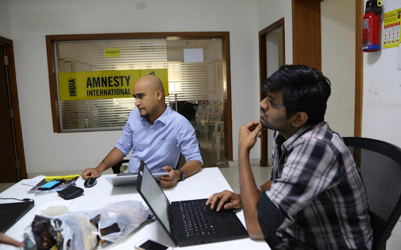 The announcement by the Indian government has come at a time when Narendra Modi's government are facing growing accusations of silencing human rights activists - Aijaz Rahi/AP