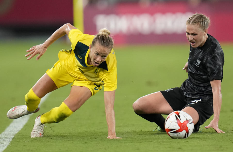 New Zealand's CJ Bott, right, and Australia's Aivi Luik vie for the ball during a women's soccer match at the 2020 Summer Olympics, Wednesday, July 21, 2021, in Tokyo. (AP Photo/Ricardo Mazalan)