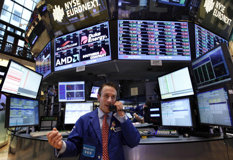 FILE-In a  Friday, Aug. 31, 2012, file photo, a trader works on the floor of the New York Stock Exchange, in New York. Markets were subdued Wednesday Oct. 3, 2012 as investors awaited a run of U.S. economic figures. (AP Photo/Jason DeCrow, File)
