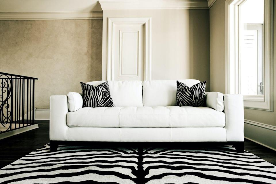 <p>Before there was cowhide, there were zebra rugs. They gave rooms an exotic flair in the '70s, but the animal print rug tends to look more cheesy than worldly in 2019. </p>