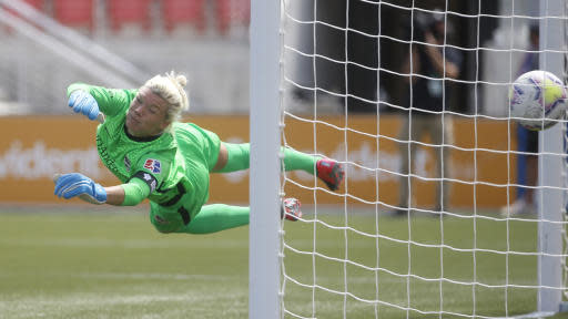 Houston Dash goalkeeper Jane Campbell is scored against by a Utah Royals FC free kick during the second half of an NWSL Challenge Cup soccer match at Zions Bank Stadium Tuesday, June 30, 2020, Herriman, Utah. (AP Photo/Rick Bowmer)