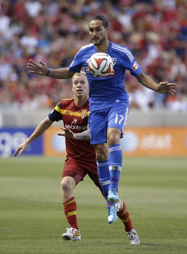 Montreal Impact's Issey Nakajima-Farran (17) controls the ball as Real Salt Lake's Luke Mulholland defends during the first half of an MLS Soccer game Thursday, July 24, 2014, in Sandy, Utah. (AP Photo/Rick Bowmer)