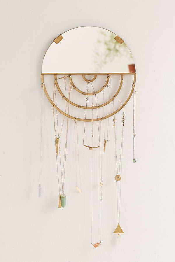 "<i>Buy it from <a href=""https://www.urbanoutfitters.com/shop/aimee-jewelry-storage-hanging-mirror?category=gift-ideas-for-women&amp;color=027&amp;reviewPage=3"" rel=""nofollow noopener"" target=""_blank"" data-ylk=""slk:Urban Outfitters"" class=""link rapid-noclick-resp"">Urban Outfitters</a> for&nbsp;$29.</i>"