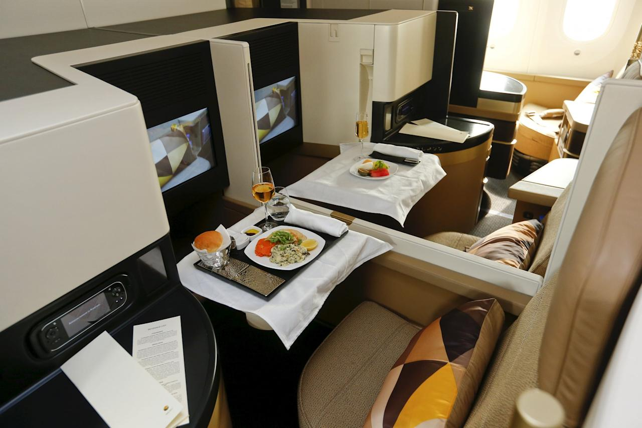 <p>First class seats aboard an Etihad Airways Boeing 787 Dreamliner passenger jet are pictured during a media presentation at Zurich airport near the town of Kloten July 6, 2015. While Etihad Airways often ranks well with passengers, it didn't make TripAdvisor's top 10 list this year. (Reuters) </p>
