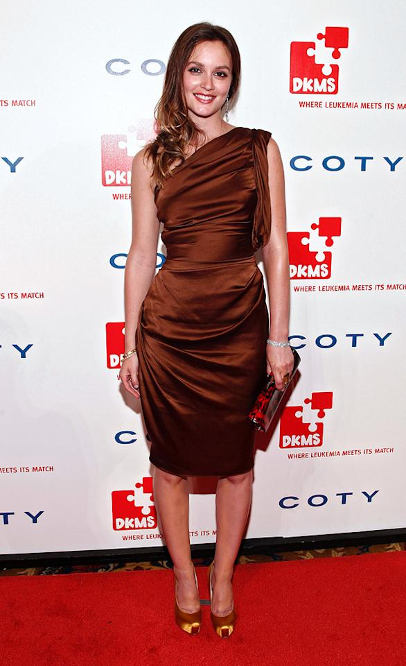 """Leighton Meester also came out for the charity soiree. The """"Gossip Girl"""" donned a tobacco-colored one-shoulder dress by Vera Wang for the occasion, which she accessorized with gold Brian Atwood """"Debra"""" pumps, Cathy Waterman jewels, and a Jimmy Choo """"Tube"""" clutch. Brian Ach/<a href=""""http://www.wireimage.com"""" target=""""new"""">WireImage.com</a> - April 28, 2011"""