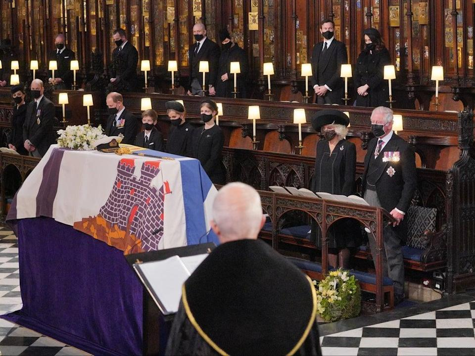 Mourners, including the Duchess and Duke of Cambridge, attend the funeral of Prince Philip at St George's Chapel, Windsor Castle, on 17 April  (Getty)
