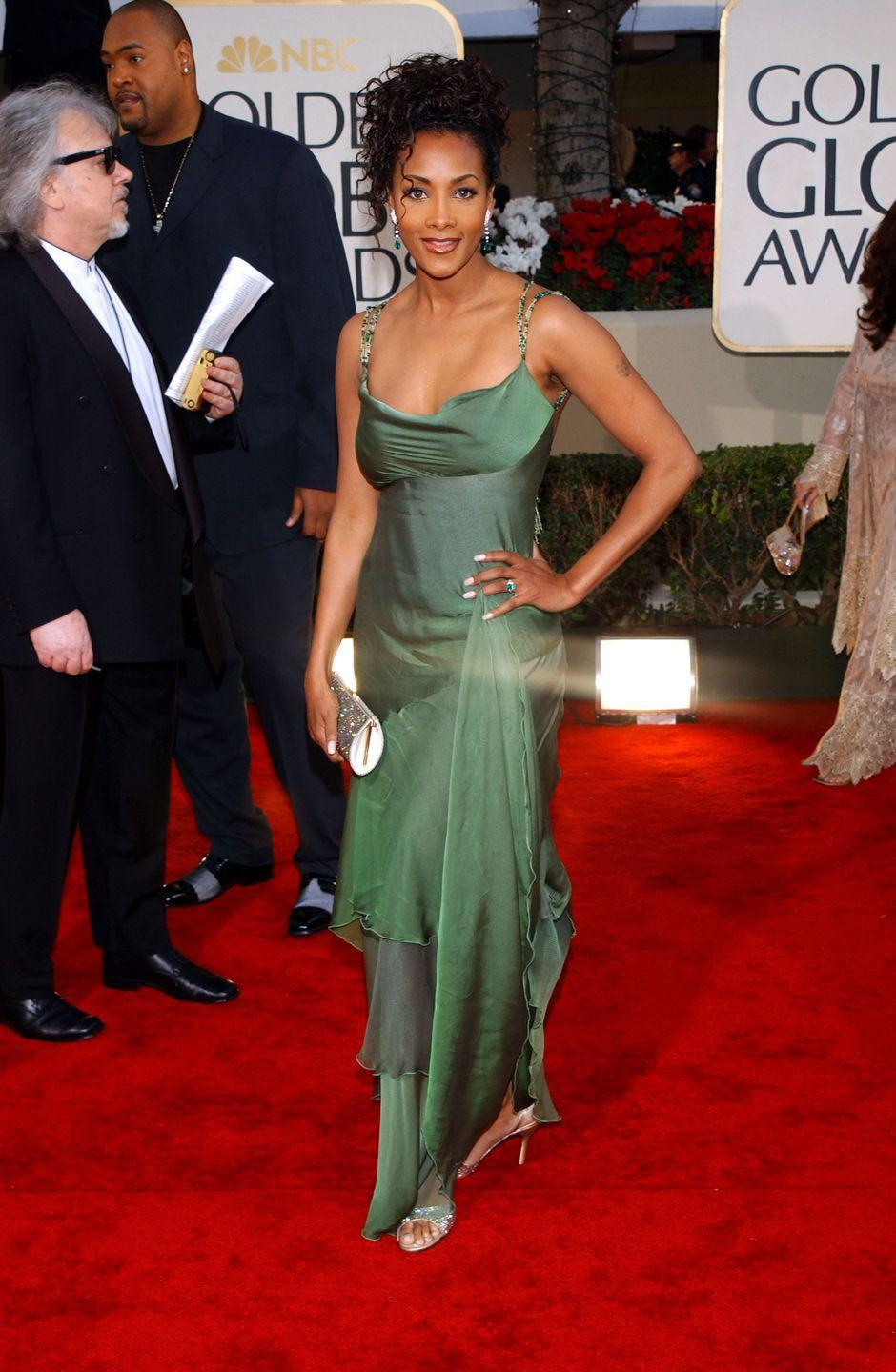 <p>All eyes were on the actress when she wore this asymmetrical green number in 2002. </p>