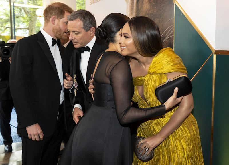 Britain's Prince Harry, Duke of Sussex (L) chats with Disney CEO Robert Iger as Britain's Meghan, Duchess of Sussex (2nd R) embraces US singer-songwriter Beyoncé (R) as they attend the European premiere of the film The Lion King in London on July 14, 2019. (Photo by Niklas HALLE'N / POOL / AFP) (Photo credit should read NIKLAS HALLE'N/AFP via Getty Images)