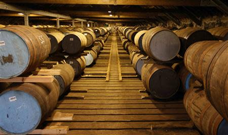 Whisky barrels are seen in the warehouse of the Diageo Cardhu distillery in Scotland March 21, 2014. REUTERS/Russell Cheyne