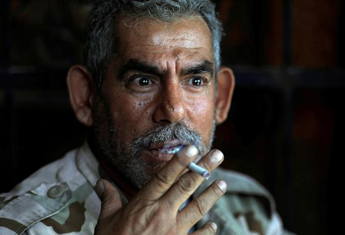 <p>An Iraqi soldier from 9th Armoured Division smokes a cigarette inside a house that has become their temporary advance command post in the Shifa neighbourhood in western Mosul, Iraq, June 15, 2017. (Photo: Erik De Castro/Reuters) </p>