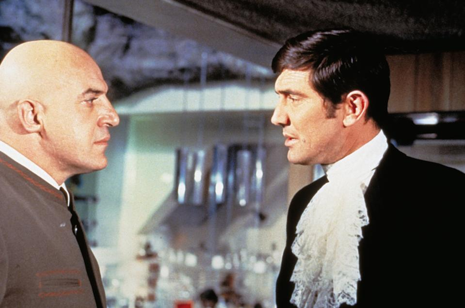 Australian actor George Lazenby and American Telly Savalas on the set of On Her Majesty Secret Service, directed by British Peter R. Hunt. (Photo by Sunset Boulevard/Corbis via Getty Images)