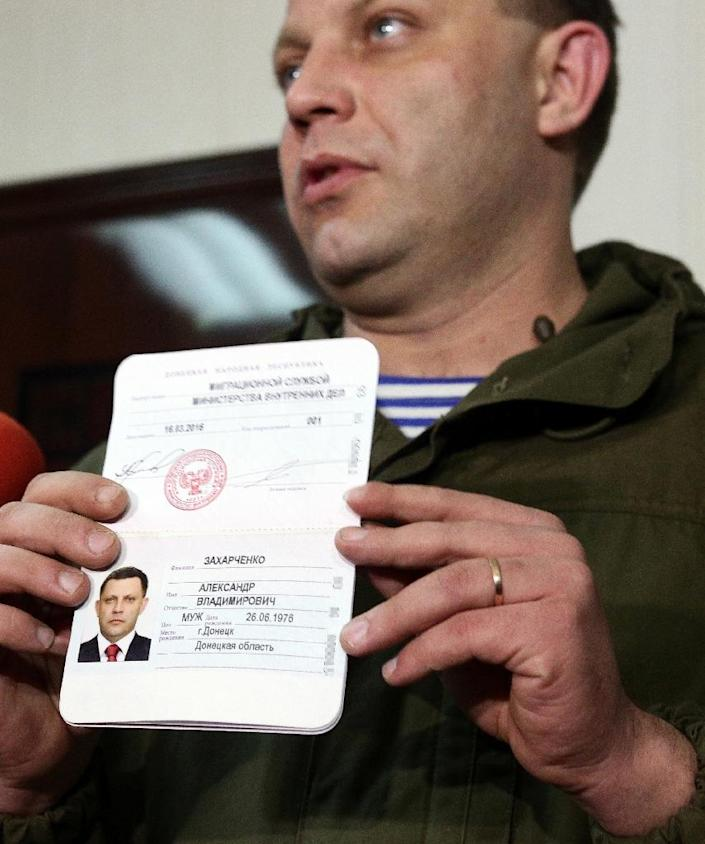 Alexander Zakharchenko, leader of the self-proclaimed People's Republic of Donetsk, displays his new passport in Donetsk in March last year (AFP Photo/ALEKSEY FILIPPOV)