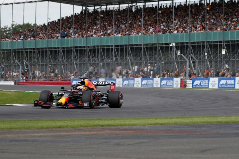 Fans in the stands: Red Bull's Max Verstappen drives at Luffield Corner during practice in front of 90,000 fans at Silverstone