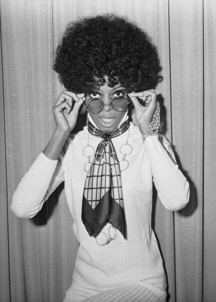 <p>Though the item itself has never really gone out of style, it's the way that Diana Ross used to wear the style back in the day that we're starting to see more and more of. Knotted loosely around the neck in a tie-like fashion, the printed silk scarf is strategically layered over a turtleneck sweater with a long necklace for a multifaceted look. Consider investing in a signature twilly from Hermès—that way, you can wear it both around your neck and looped through the handles of your favorite tote.</p>