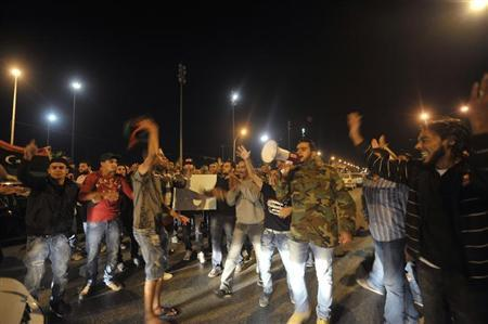 Anti-government protesters demonstrate against bombings and assassinations in Benghazi
