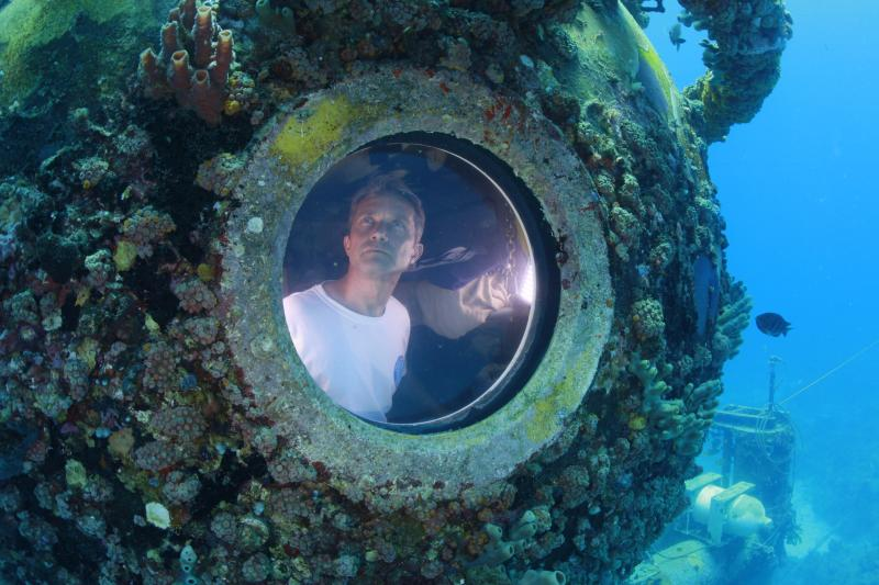 """Fabien Cousteau is pictured inside the marine laboratory Aquarius in this undated handout photo obtained by Reuters July 2, 2014. Cousteau, grandson of famed French oceanographer Jacques Cousteau, emerged from the turquoise waters off the Florida Keys on July 2, 2014 morning, marking the end of a record-breaking, 31-day stay in an underwater habitat with a team of scientists and documentary filmmakers. The younger Cousteau, 46, along with two """"aquanauts,"""" took the 60-foot (18-meter) dive to Aquarius, a 43-foot-long (18-meter-long) laboratory resting off of Key Largo, on June 1 following years of preparation and delay. REUTERS/Kip Evans/Mission Blue/Handout via Reuters (UNITED STATES - Tags: SCIENCE TECHNOLOGY ANIMALS ENVIRONMENT) ATTENTION EDITORS - THIS PICTURE WAS PROVIDED BY A THIRD PARTY. REUTERS IS UNABLE TO INDEPENDENTLY VERIFY THE AUTHENTICITY, CONTENT, LOCATION OR DATE OF THIS IMAGE. FOR EDITORIAL USE ONLY. NOT FOR SALE FOR MARKETING OR ADVERTISING CAMPAIGNS. THIS PICTURE IS DISTRIBUTED EXACTLY AS RECEIVED BY REUTERS, AS A SERVICE TO CLIENTS. NO SALES. NO ARCHIVES. MANDATORY CREDIT"""