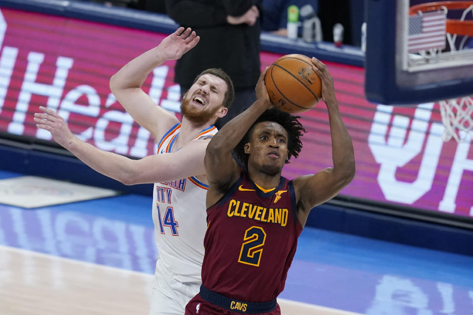 Cleveland Cavaliers guard Collin Sexton (2) goes to the basket in front of Oklahoma City Thunder guard Svi Mykhailiuk (14) during the second half of an NBA basketball game Thursday, April 8, 2021, in Oklahoma City. (AP Photo/Sue Ogrocki)