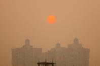 A residential building is seen shrouded in smog in Noida on the outskirts of New Delhi