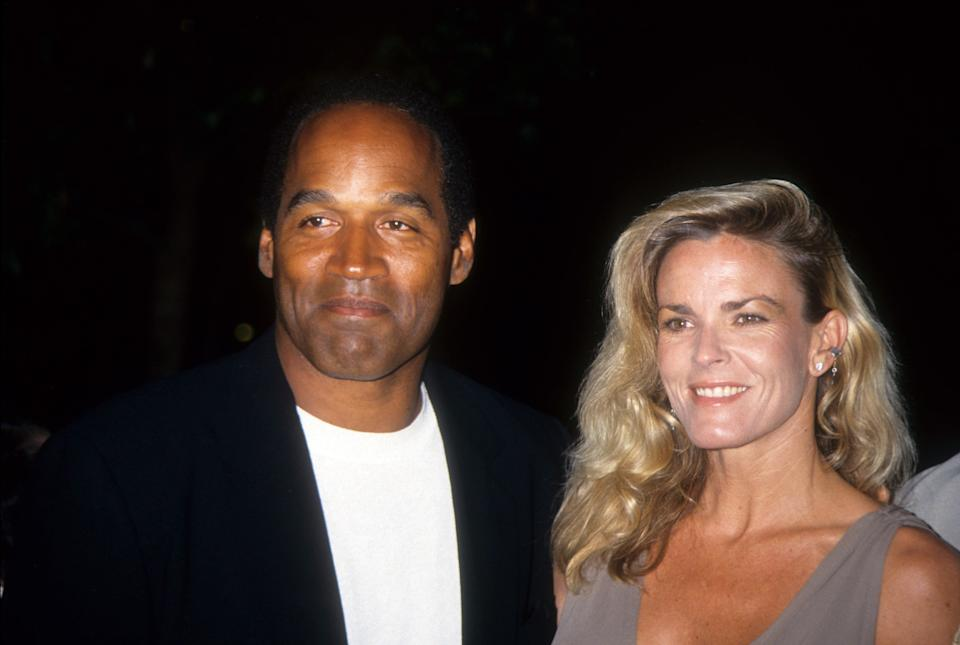 O.J. Simpson (left) and Nicole Brown Simpson (right) smile for a photograph