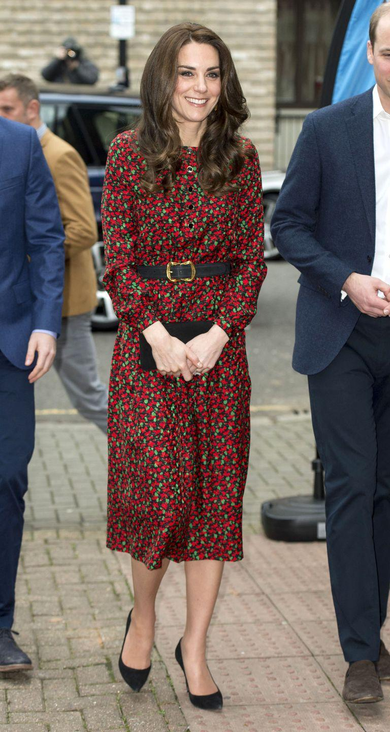 <p>The Duchess wears a Red floral dress by Vanessa Seward with a black belt, suede clutch and pointed-toe pumps in London.</p>