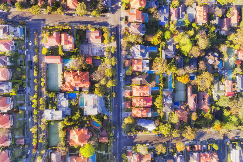 Blocks of prestigeous wealthy houses on lower North Shore in Sydney - rich suburb of Mosman in elevated top down aerial view.