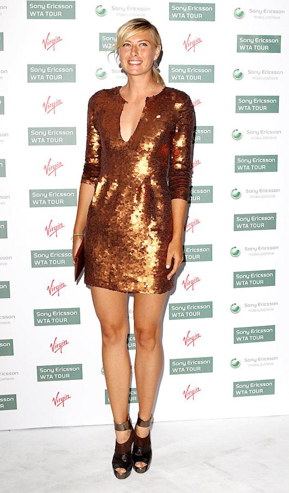 """The Williams' tennis rival, 2004 Wimbledon champ Maria Sharapova, was also on-hand. The 23-year-old blond bombshell nearly outshone the sisters in a copper sequined dress and futuristic platform pumps. Mike Marsland/<a href=""""http://www.wireimage.com"""" target=""""new"""">WireImage.com</a> - June 17, 2010"""