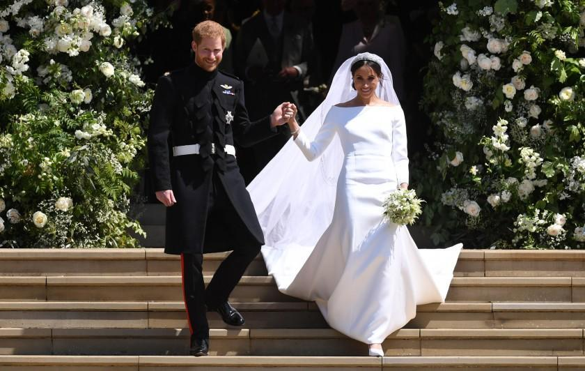 Mandatory Credit: Photo by NEIL HALL/POOL/EPA-EFE/REX/Shutterstock (9684230lz) Meghan Markle and Prince Harry Royal Wedding of Prince Harry and Meghan Markle in Windsor, United Kingdom - 19 May 2018 Britain's Prince Harry (L), Duke of Sussex and Meghan (R), Duchess of Sussex exit St George's Chapel in Windsor Castle after their royal wedding ceremony, in Windsor, Britain, 19 May 2018. The couple have been bestowed the royal titles of Duke and Duchess of Sussex on them by the British monarch. ** Usable by LA, CT and MoD ONLY **
