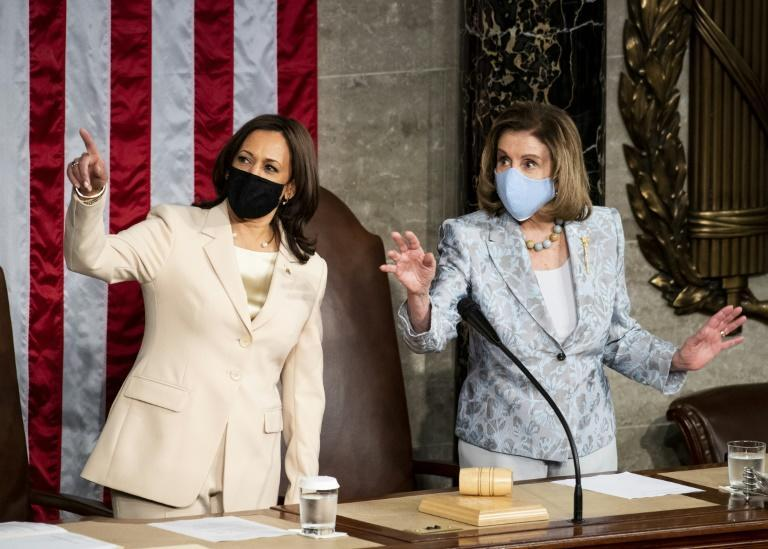Vice President Kamala Harris and Speaker of the House Nancy Pelosi take the speaker's podium