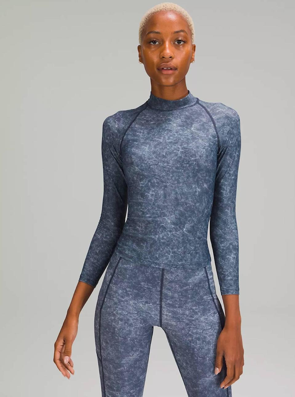 """Sleek and practical, this rash guard will carry you all through the summer. It's made of a soft material that's gentle on the skin, it dries quickly, and the hip-length cut makes it wearable outside of the pool. $78, Lululemon. <a href=""""https://shop.lululemon.com/p/tops-swim/Waterside-UVP-Long-Sleeve-Rash-Guard/_/prod10370220"""" rel=""""nofollow noopener"""" target=""""_blank"""" data-ylk=""""slk:Get it now!"""" class=""""link rapid-noclick-resp"""">Get it now!</a>"""