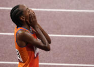 Sifan Hassan, of Netherlands celebrates after winning the gold medal in the final of the women's 5,000-meters at the 2020 Summer Olympics, Monday, Aug. 2, 2021, in Tokyo, Japan. (AP Photo/Charlie Riedel)