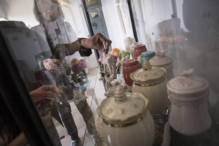 Stacks of Urns in Wuhan Prompt New Questions of Virus's Toll