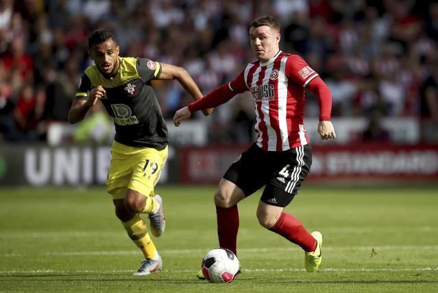 Southampton's Sofiane Boufal, left, and Sheffield United's John Fleck battle for the ball during their English Premier League soccer match at Bramall Lane, Sheffield, England, Saturday, Sept. 14, 2019. (Tim Goode/PA via AP)