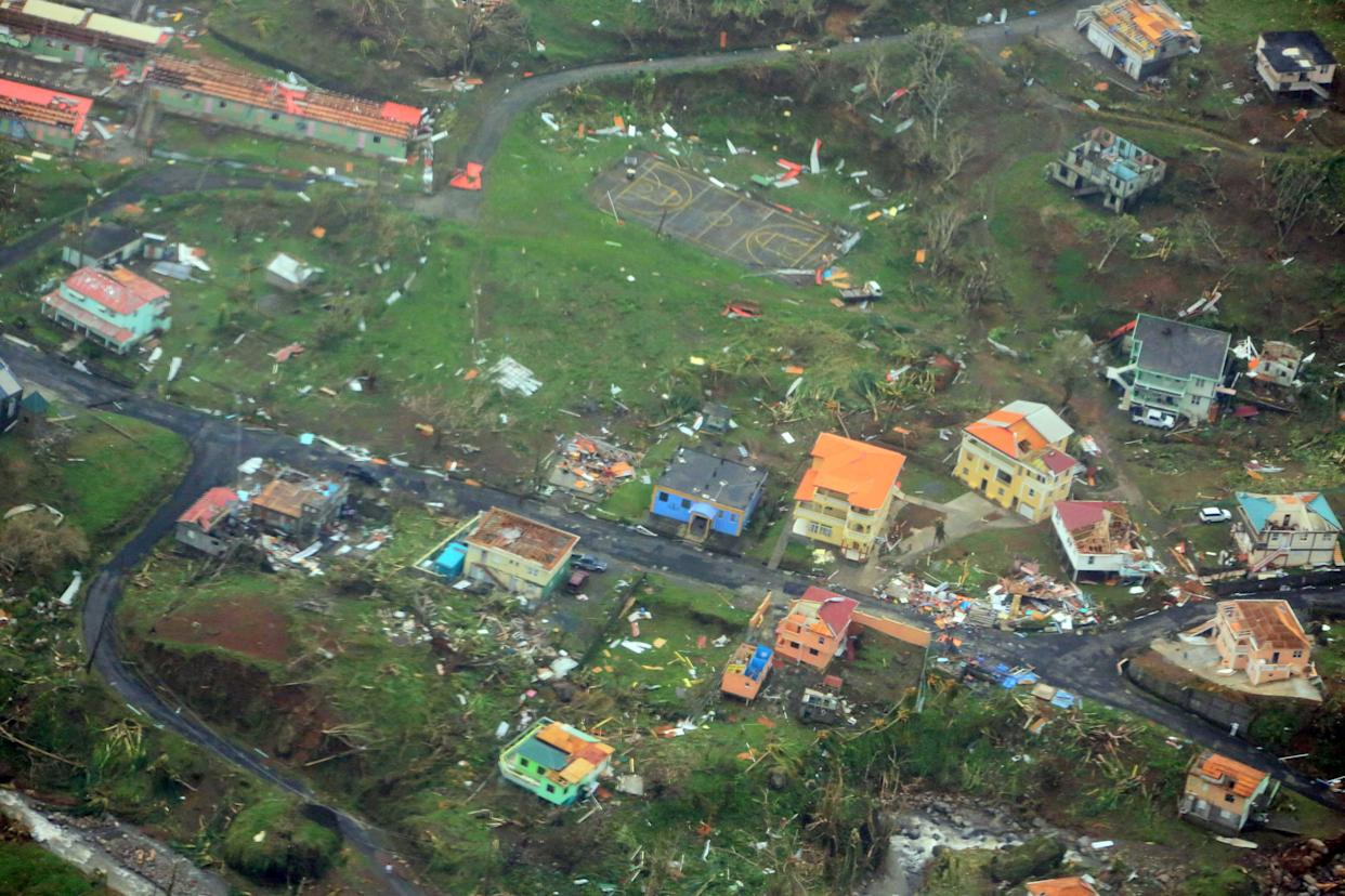 Damaged homes from Hurricane Maria are shown in this aerial photo over the island of Dominica on Sept. 19, 2017.