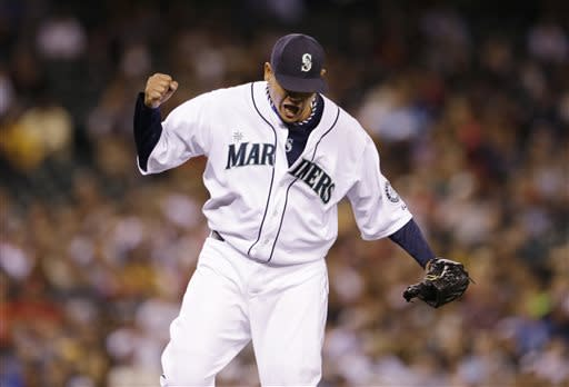 Seattle Mariners starting pitcher Felix Hernandez reacts to the final out against the Los Angeles Angels in the eighth inning of a baseball game Saturday, July 13, 2013, in Seattle. (AP Photo/Elaine Thompson)