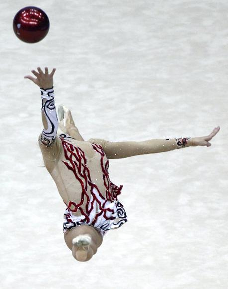 Anna Gurbanova of Azerbaijan performs with the ball during the individual all-around competition final at the Rhythmic Gymnastics World Championships in Moscow September 24, 2010. (REUTERS/Mikhail Voskresensky)