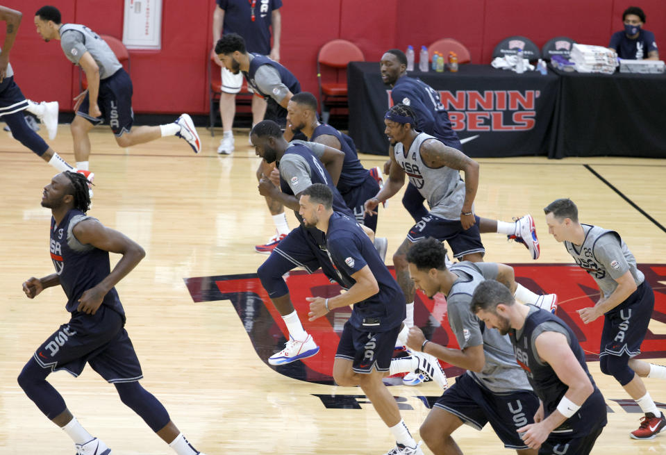 Players run down the court in a training drill.